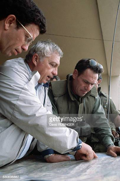 Israeli armed forces Brigadier General Amos Yaron and Israeli Prime Minister Ariel Sharon study a map during the Israeli occupation of Lebanon in...