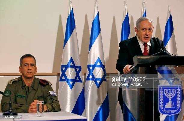 Israeli Army Chief of Staff, Lieutenant General Aviv Kochavi, listens to Prime Minister Benjamin Netanyahu as he addresses the media at the Defence...