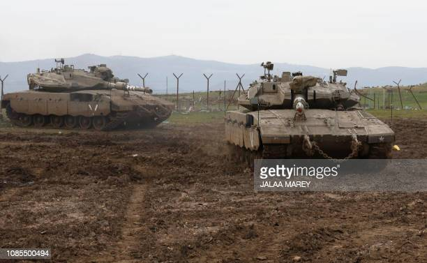 Israeli army Merkava tanks gather in the Israeliannexed Golan Heights on January 20 2019 Israel's military said its air defence systems intercepted a...