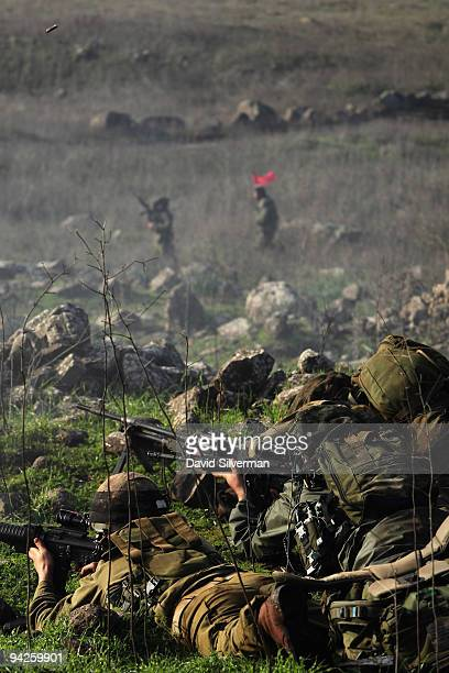 Israeli army paratroopers open fire during a livefire training exercise December 10 2009 on the Golan Heights The Israeli Knesset approved yesterday...