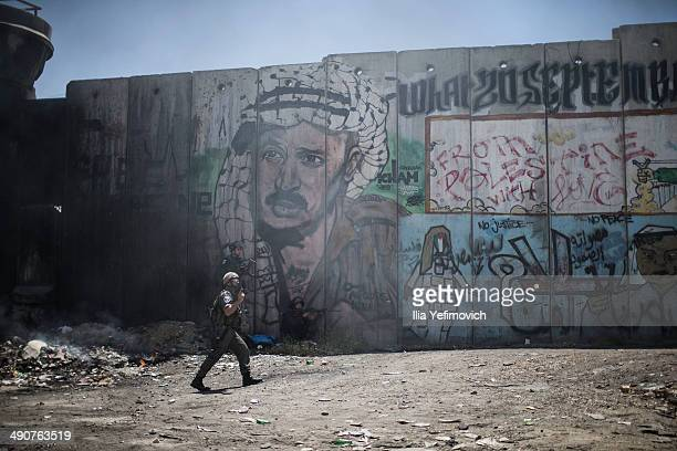 Israeli Army soldiers seen during clashes with Palestinian youths during Nakba day on May 15 2014 near the Qalandia checkpoint at the outskirts of...