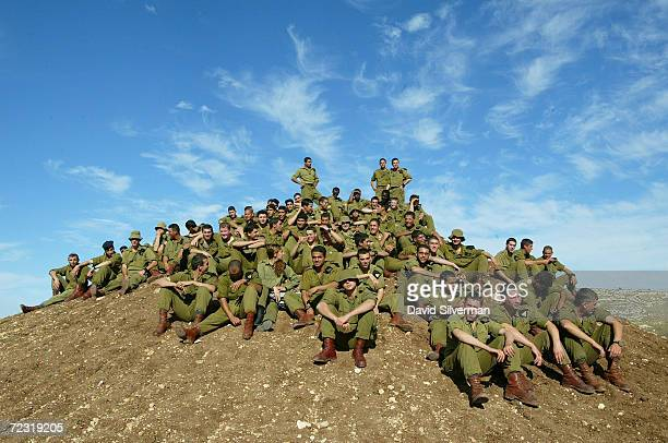 Israeli army soldiers wait on a hillock for the arrival of Israeli Prime Minister Ariel Sharon January 7, 2003 to the Adam army training base in...