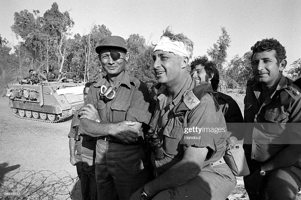 Israeli army Southern Command General Ariel Sharon with Defense Minister Moshe Dayan during the Yom Kippur War in October 1973 on the western bank of the Suez Canal in Egypt.