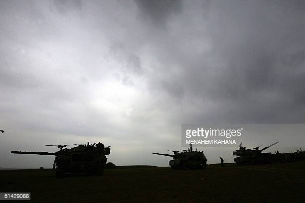 Israeli army tanks are deployed near Kibbutz Mefalsim before crossing the border into te Gaza Strip 06 October 2004 Israeli troops are pressing ahead...