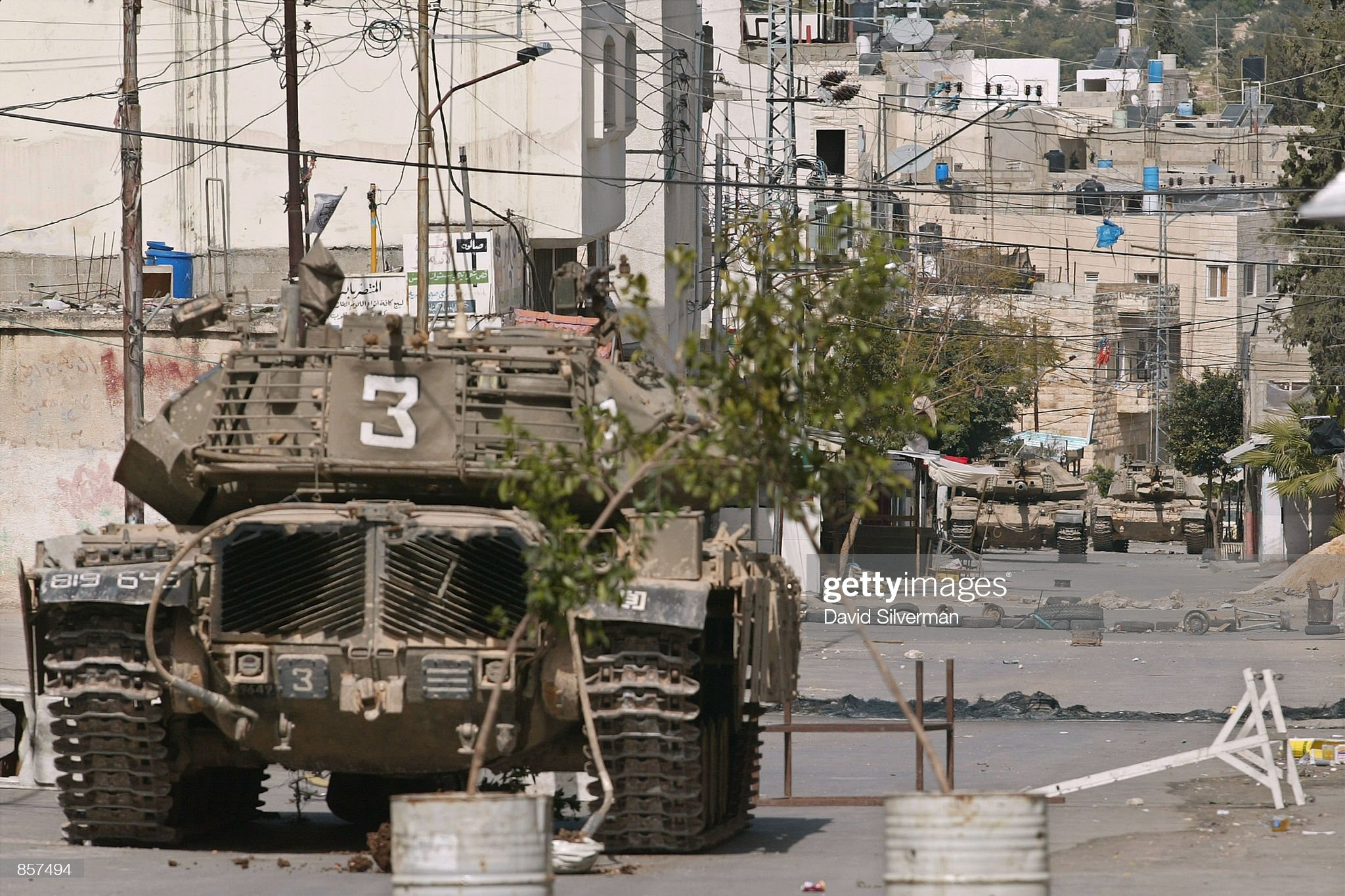 https://media.gettyimages.com/photos/israeli-army-tanks-control-both-sides-of-the-main-road-march-7-2002-picture-id857494?s=2048x2048