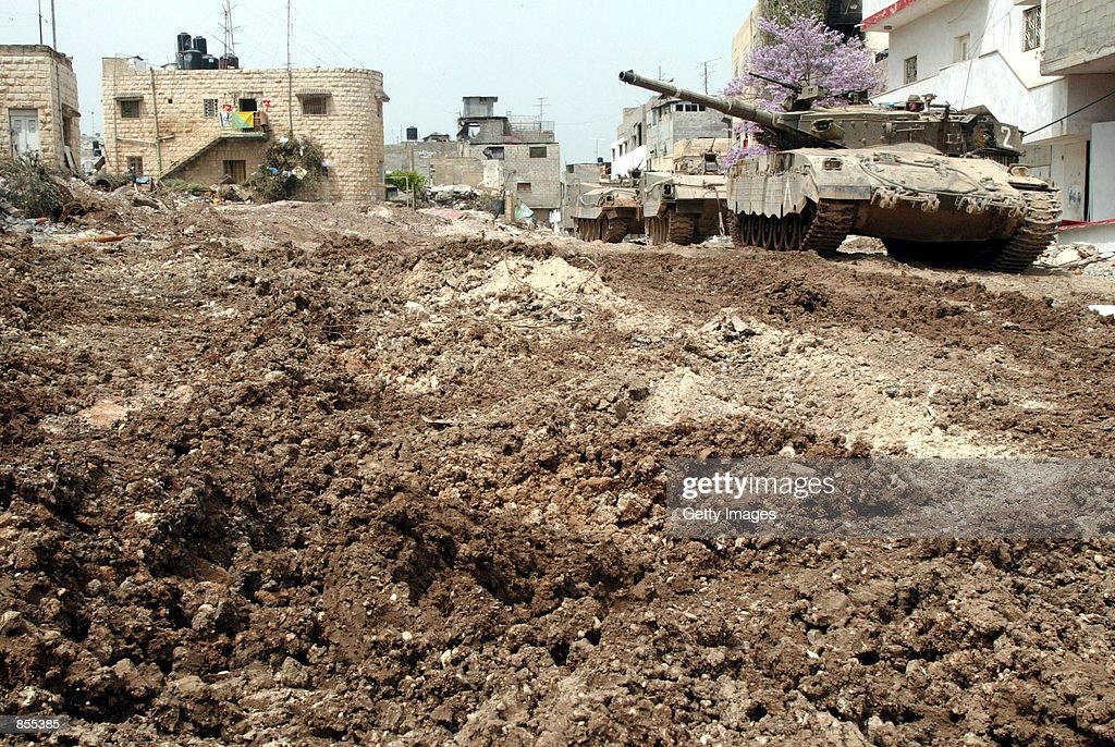 Israeli army tanks make their way through the Jenin refugee camp