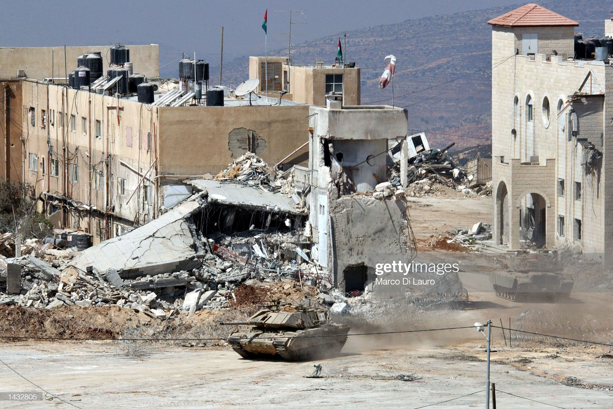 https://media.gettyimages.com/photos/israeli-army-tanks-roll-into-palestinian-leader-yasser-arafats-26-picture-id1432805?s=2048x2048
