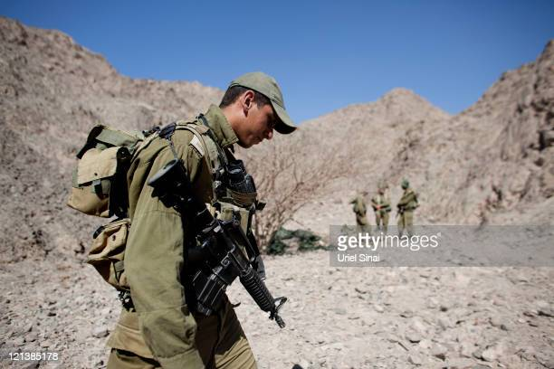 Israeli army troops stand guard on the Israeli Egyptian border following yesterday's series of coordinated gun and roadside bomb attacks against...