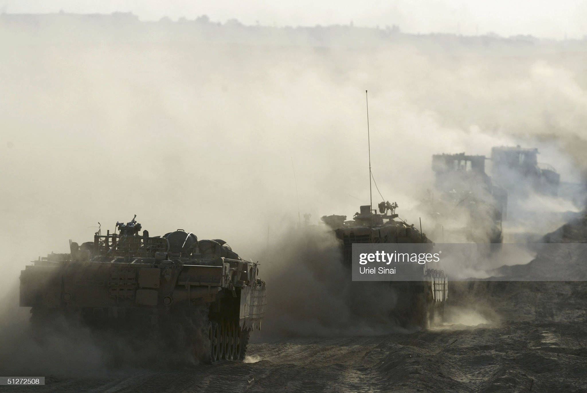 https://media.gettyimages.com/photos/israeli-army-vehicles-drive-from-israel-into-gaza-on-september-8-2004-picture-id51272508?s=2048x2048