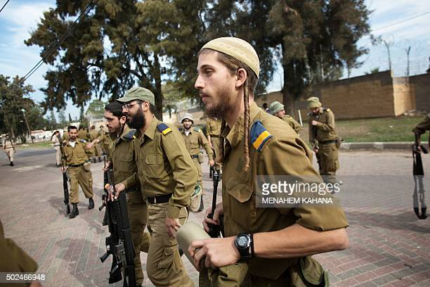 SMITH Israeli army's newlyenrolled soldiers of the Shachar Kachol UltraOrthodox Jewish unit take part in a training session at the technical Air...