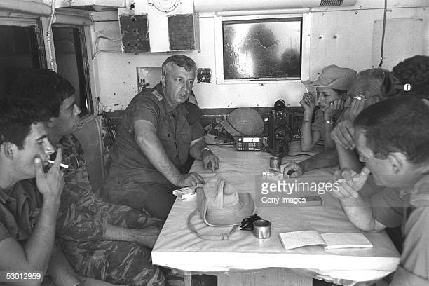 Israeli army's Southern Command General Ariel Sharon 2nd L meets with his officers a week before the June 5 start of the SixDay War May 29 1967 at...