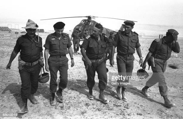 Israeli army's Southern Command General Ariel Sharon C arrives by helicopter with Generals Haim BarLev 2nd L and Yishayahu Gavish 2nd R at an army...