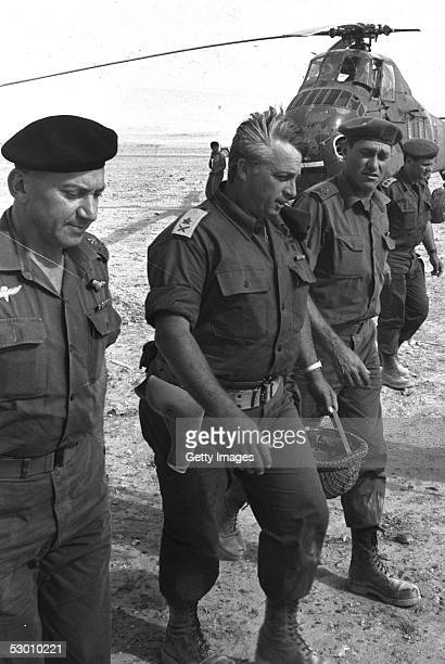 Israeli army's Southern Command General Ariel Sharon C arrives by helicopter with Generals Haim BarLev L and Yishayahu Gavish R at an army base just...
