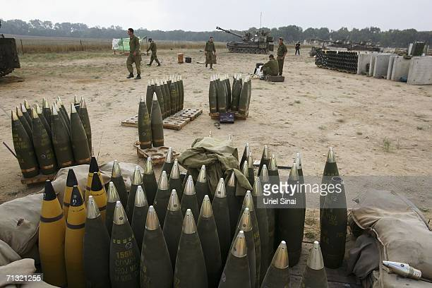 Israeli artillery shells sit beside mobile artillery firing units as soldeirs wait for orders to resume shelling the Gaza Strip from the Israeli...
