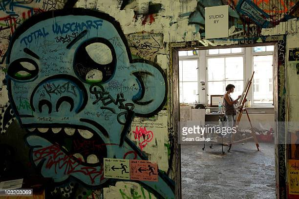 Israeli artist Yoel Herold paints in her studio at the Tacheles artists' collective on August 2 2010 in Berlin Germany The Tacheles which was formed...