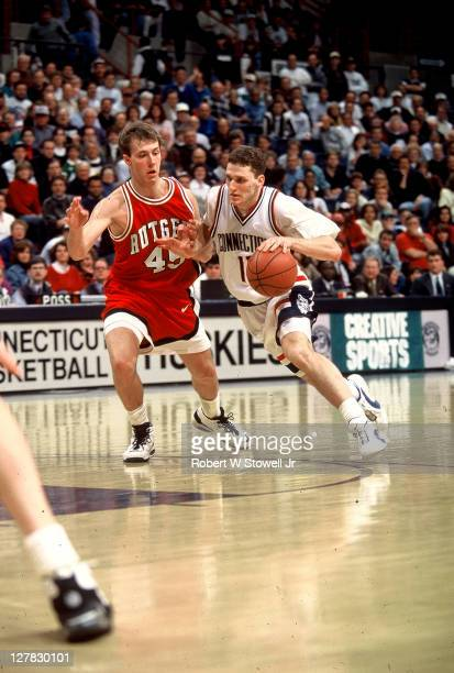 Israeli basketball player Doron Sheffer of the University of Connecticut in action against a Rutgers University defender, Hartford, Connecticut, 1994.
