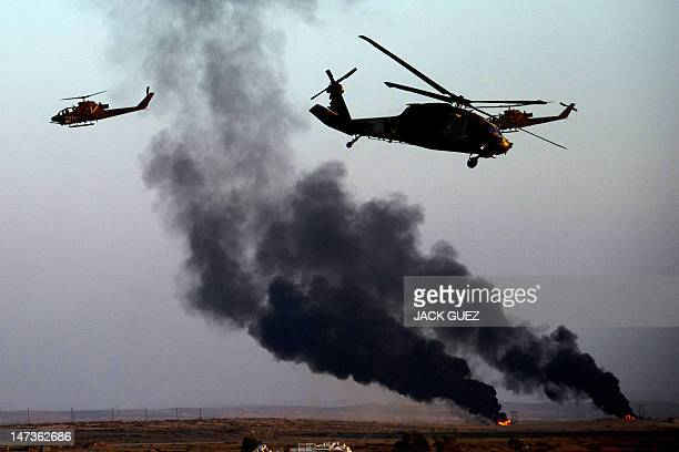 Israeli Bell AH1 Cobra's perform during an air show at the graduation ceremony of Israeli pilots at the Hatzerim air force base in the Negev desert...
