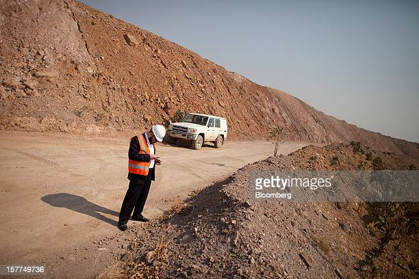 Israeli billionaire Dan Gertler checks his smartphones on a roadside during a tour of the Katanga Mining Ltd copper and cobalt mine complex in...