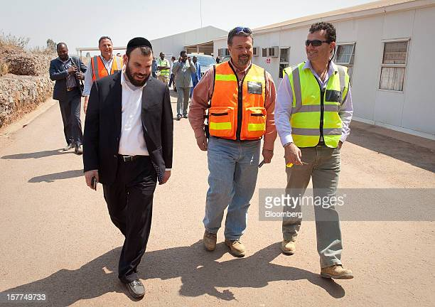 Israeli billionaire Dan Gertler left is accompanied by Jeffrey Best chief executive officer of Katanga Mining Ltd center and other staff during a...