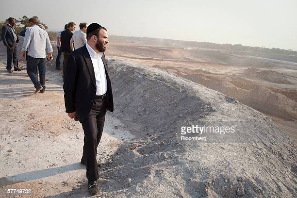 Israeli billionaire Dan Gertler looks across the open pit mining operations at Comide SPRL's Mashitu copper mine operated by Eurasian Natural...