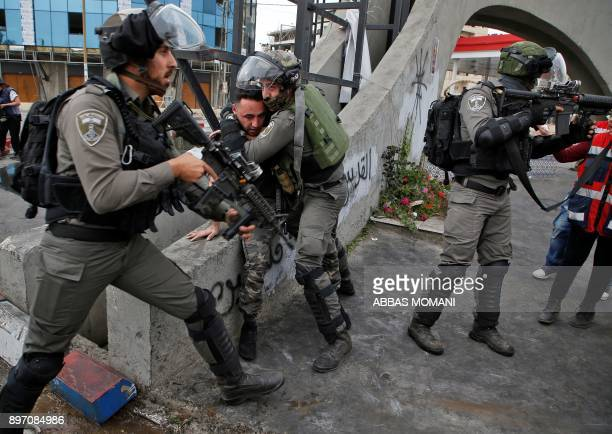 TOPSHOT Israeli border guards detain a Palestinian man during clashes with Palestinian protesters north of Ramallah in the Israeli occupied West Bank...
