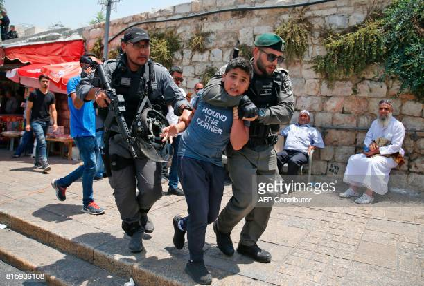 Israeli border guards detain a Palestinian youth during a demonstration outside the Lions Gate a main entrance to AlAqsa mosque compound due to...