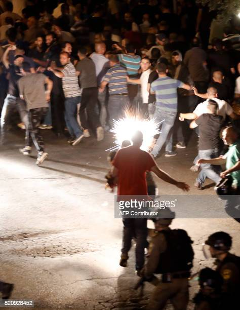 Israeli border guards fire a stun grenade in an attempt to disperse Palestinian Muslim worshippers outside Lions' Gate a main entrance to the AlAqsa...