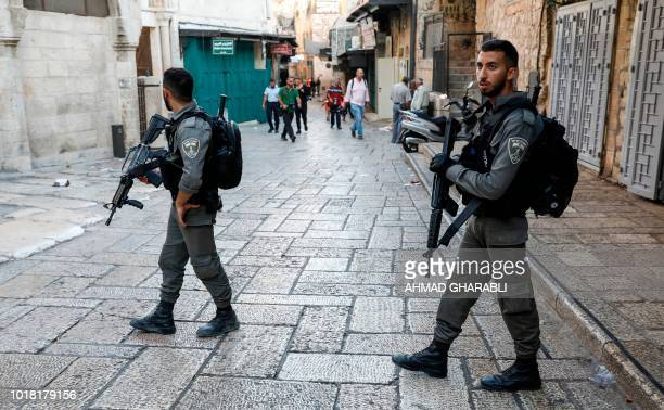 Israeli border guards patrol a street in the Old City of Jerusalem on August 17 following an attack on an Israeli policeman Israeli police shot a...