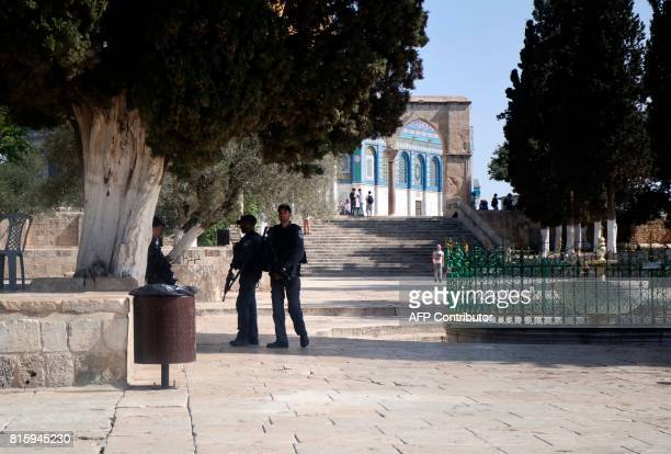 Israeli border guards stand at attention near the AlAqsa Mosque compound in the old city of Jerusalem on July 17 after Palestinian Muslim worshippers...