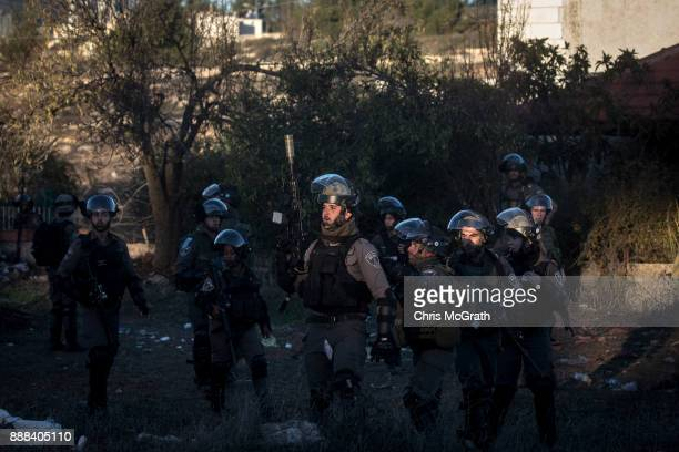 Israeli border guards watch on from a position during clashes near an Israeli checkpoint on December 8 2017 in Ramallah West Bank At least 50...