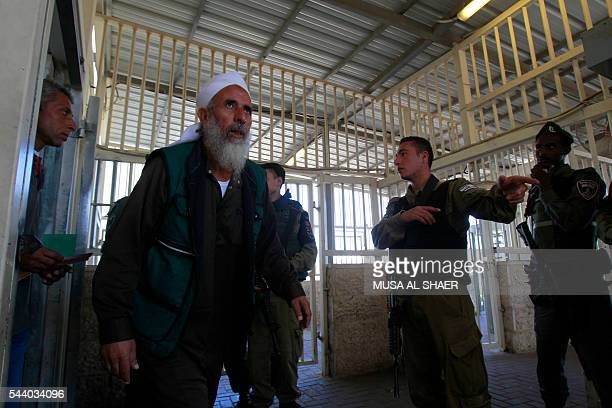 Israeli border police check Palestinian men's West Bank identity cards at an Israeli checkpoint between the town of Bethlehem and Jerusalem as he...