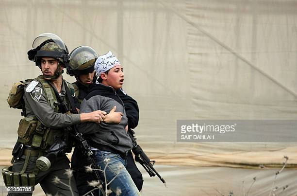 Israeli border police detain a Palestinian demonstrator following clashes at the entrance of the Jalama checkpoint near the West Bank city of Jenin...
