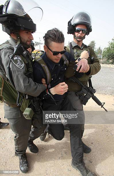 Israeli border police evacuate demonstrators who were attempting to close the main road linking Jerusalem and Hebron while calling for the release...