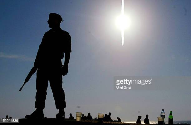 Israeli Border Police keep guard on a beach boardwalk near the site of a suicide bombing attack at a nightclub February 26, 2005 in Tel Aviv, Israel....