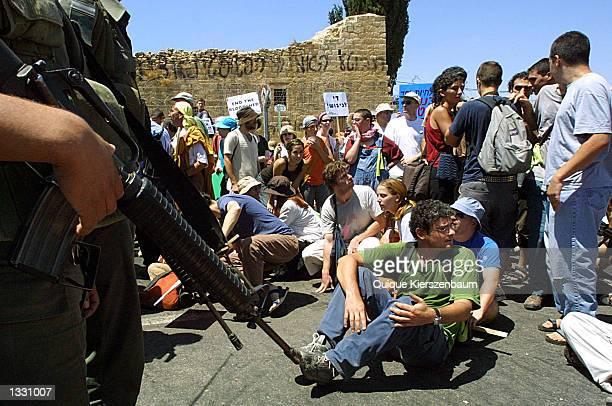 Israeli border police officers prevent peace demonstrators from reaching Bethlehem August 102002 in Jerusalem Israel The peace demonstrators were...