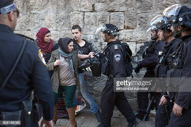 Israeli border police scuffle with Palestinians as they clear a street following an attack by three Palestinian assailants at Damascus Gate a main...