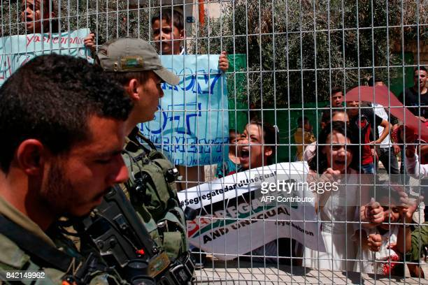 Israeli border police stand guard during a demonstration organised by young Palestinians in Hebron on September 3 against a recent decision by Israel...