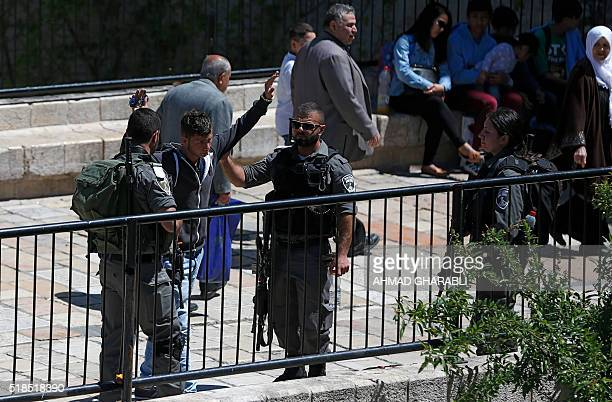 Israeli border policemen frisk a Palestinian man at Damascus Gate a main entrance to Jerusalem's Old City on April 1 2016 / AFP / AHMAD GHARABLI