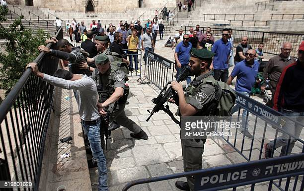 Israeli border policemen frisk Palestinian men at Damascus Gate a main entrance to Jerusalem's Old City before the Friday prayer at the alAqsa mosque...