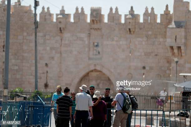 Israeli border policemen stand guard outside Damascus Gate a main entrance to Jerusalem's Old City on July 15 after security forces locked down parts...