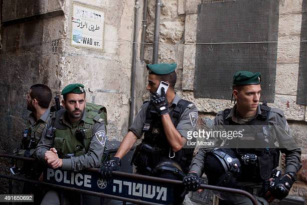 Israeli border policemen stand near a stabbing scene on October 7 2015 in Jerusalem's Old City Israel According to Israeli police a Palestinian woman...