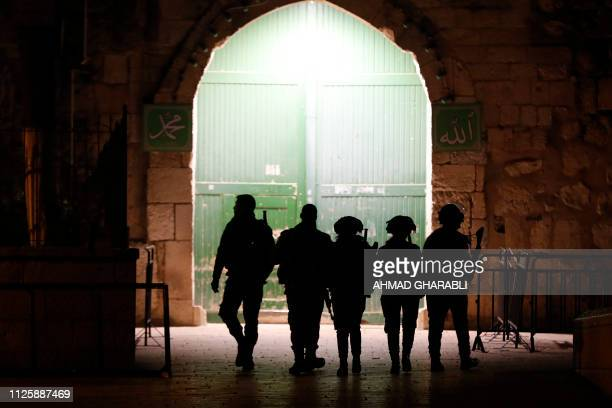 Israeli borderguards patrol an entrance to the AlAqsa compound in Jerusalem's Old City on February 19 2019 Israeli police had locked the small door...
