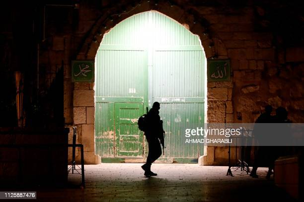 TOPSHOT Israeli borderguards patrol an entrance to the AlAqsa compound in Jerusalem's Old City on February 19 2019 Israeli police had locked the...