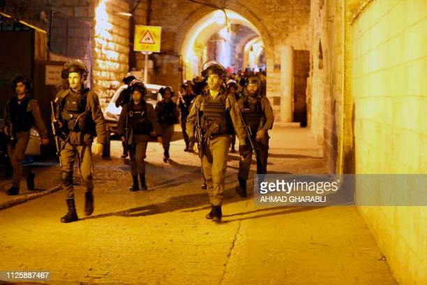 Israeli borderguards patrol near an entrance to the AlAqsa compound in Jerusalem's Old City on February 19 2019 Israeli police had locked the small...