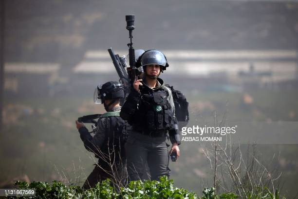 TOPSHOT Israeli borderguards stand at attention during clashes with Palestinian demonstrators from Birzeit University in Ramallah near the Jewish...