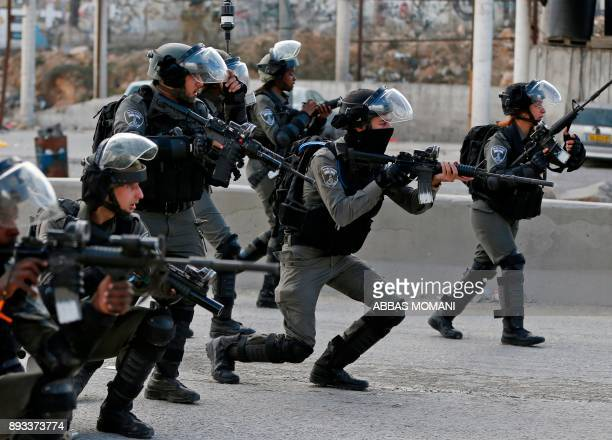 TOPSHOT Israeli borderguards take aim as Palestinian protestors gather near the West Bank checkpoint of Qalandia on the outskirts of Ramallah on...