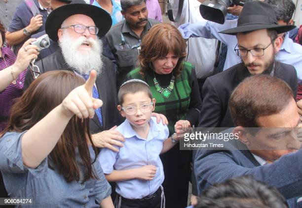 Israeli boy Moshe Holtzberg who lost his parents during the 26/11 Mumbai terror attacks arrives with grandparents at the Chabad House on January 16...