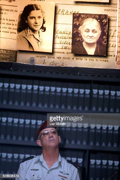 Israeli Chief of Staff General Benny Gantz looks at pictures of Jewish Holocaust victims at the Hall of Names during his visit to the Yad Vashem...