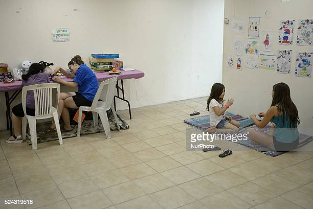 Israeli children are playing in abomb shelter in the Southern city of Sderot, on July 17, 2014. .