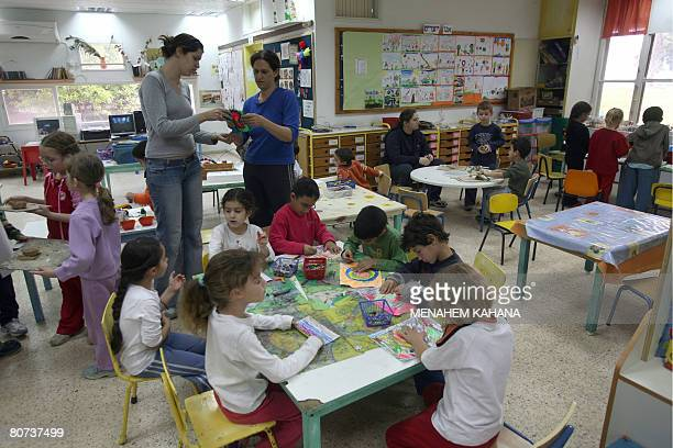 Israeli children attend at class at a kindergarten in Israel's oldest kibbutz Deganya Alef on the shores of the Sea of Galile on April 1 2008 The...